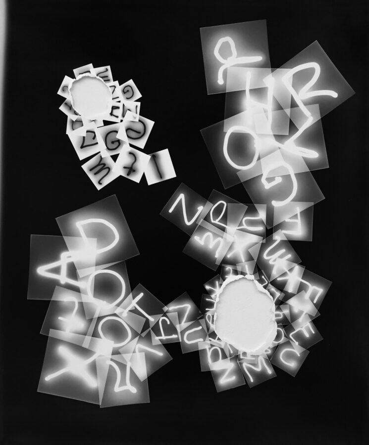 collaged photograms with letters overlaying each other in black and white