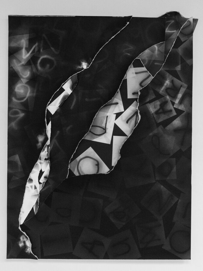 photogram with letters overlaying each other in black and white;
